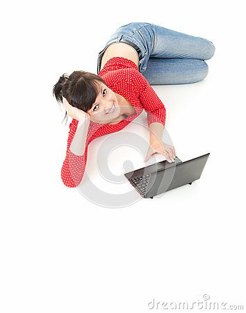 Cheerful teenage girl using laptop, full length
