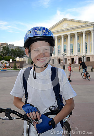 The cheerful teenager by bicycle near the Tyumen drama theater.