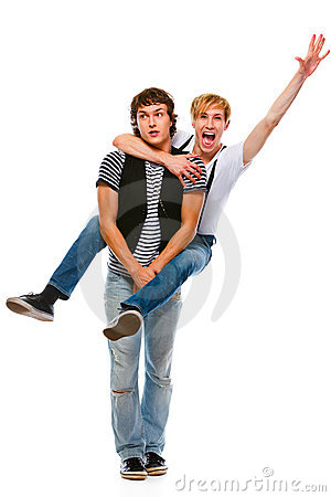 Cheerful teenager piggy backing his friend