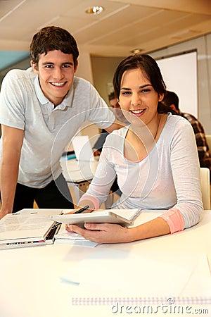 Cheerful teens in classroom