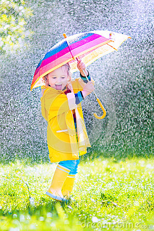 Free Cheerful Toddler With Umbrella Playing In The Rain Stock Image - 41770231