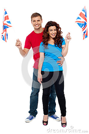 Cheerful UK supporters posing together