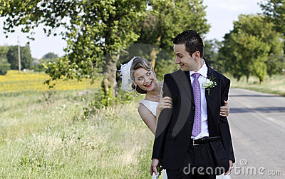 Cheerful wedding couple