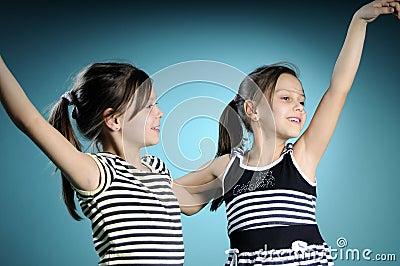 Cheerful white twins dancing