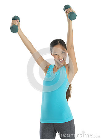 Cheerful Woman With Arms Raised Lifting Weights