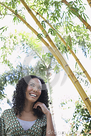 Cheerful Woman In Bamboo Forest