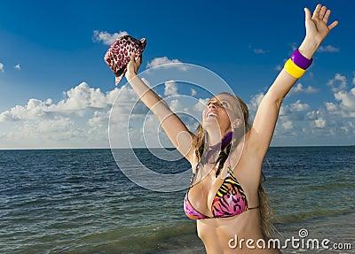 Cheerful woman in the beach