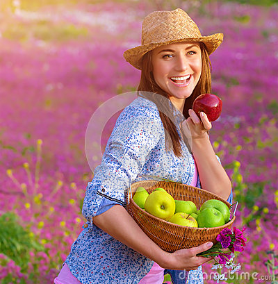 Free Cheerful Woman Biting Apple Royalty Free Stock Image - 33555996