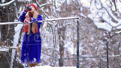 Cheerful woman drinking mulled wine in winter stock video