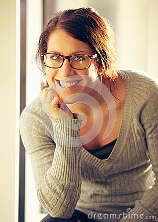 Cheerful Woman with Eyeglasses Looking at You