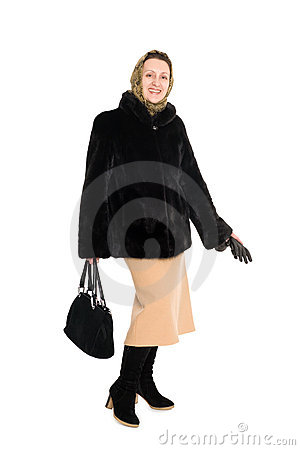 Cheerful  woman in fur coat of mink.