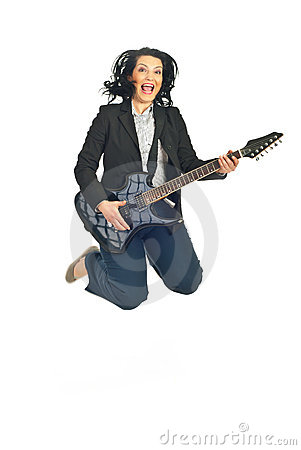 Cheerful woman with guitar jumping