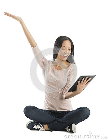 Cheerful Woman With Hand Raised Looking At Digital Tablet