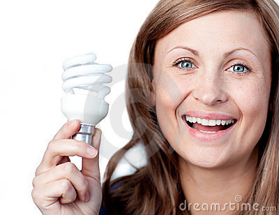 Cheerful woman holding a light bulb