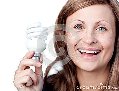 Cheerful woman holding a light bulb