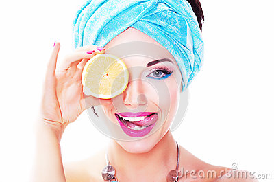 Cheerful woman - juicy delicious lemon (orange)