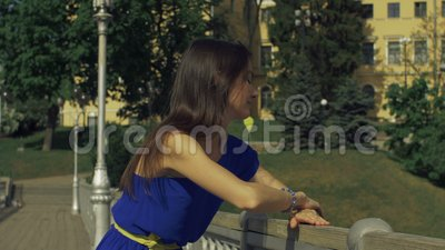 Cheerful woman leaning on the bannister of bridge stock video footage