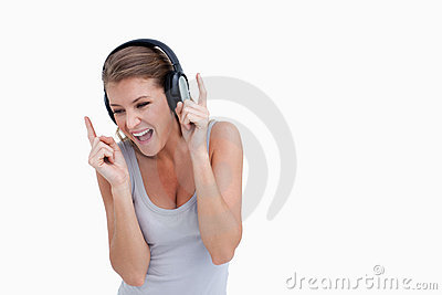 Cheerful woman listening to music