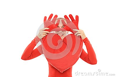 Cheerful woman with plush heart