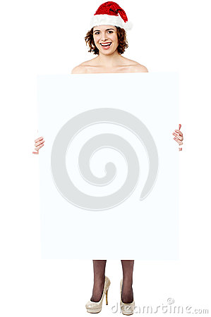 Cheerful woman presenting banner ad board