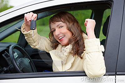 Cheerful woman showing car keys