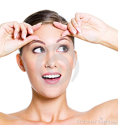Cheerful woman squeeze her forehead