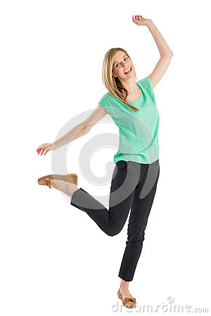 Cheerful Woman Standing On One Leg With Hands Raised