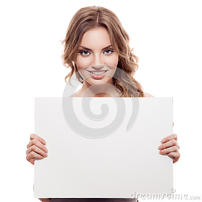 Cheerful young blond woman holding a white blank