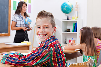 Cheerful young boy in school