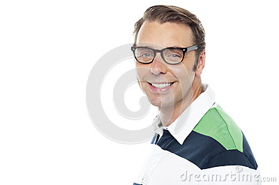Cheerful young casual guy looking at you
