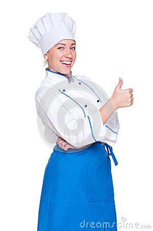 Cheerful young cook showing thumbs up