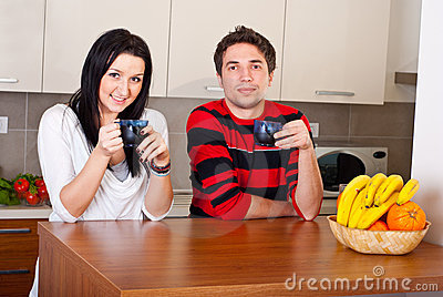 Cheerful young couple drink coffee