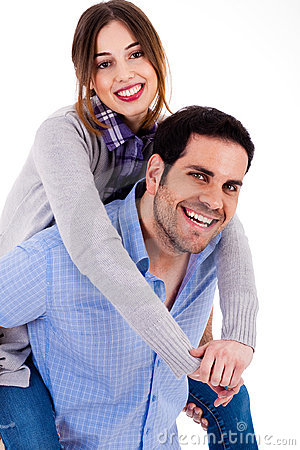 Cheerful young couple piggybacking
