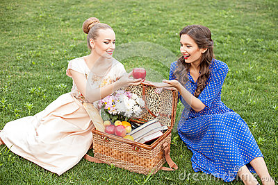 Cheerful young girls are relaxing in the nature stock for Cheerful nature