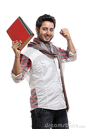 Cheerful Young indian man posing with book