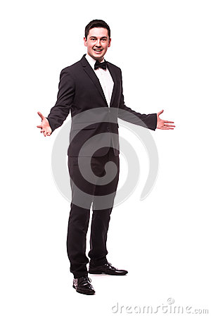Free Cheerful Young Man In Suit Welcome Sign And Smiling While Standing Stock Photography - 66803342