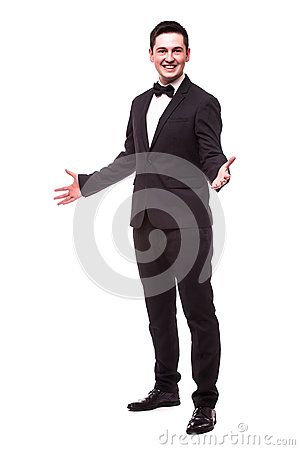 Free Cheerful Young Man In Suit Welcome Sign And Smiling While Standing Royalty Free Stock Photography - 66803387