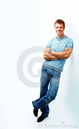Cheerful Young Man Leaning Against Wall Stock Photography