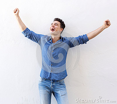 Free Cheerful Young Man With Raised Arms Celebrating Stock Photo - 58352230
