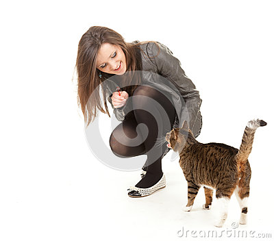 Cheerful young woman with her lovely cat