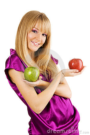 Cheerful young woman holding fresh apples