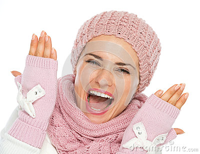 Cheerful young woman in knit winter clothing