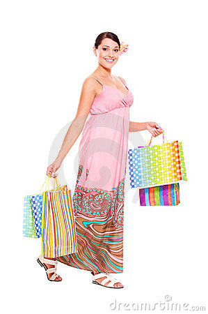 Cheerful Young Woman With Shopping Bags Royalty Free Stock Photo - Image: 21609935