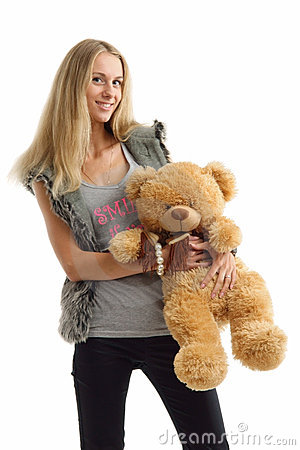 Cheerful young woman with teddy bear