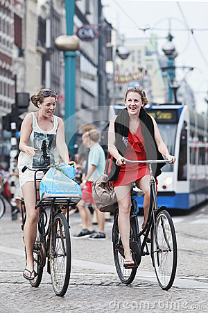 Free Cheerfull Cycling Girls In Amsterdam Royalty Free Stock Images - 28908479