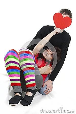 Cheerfull young female hiding boyfriend s face