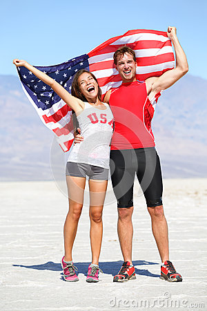 Cheering people athletes holding american USA flag