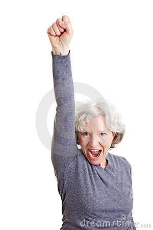 Cheering senior woman clenching her