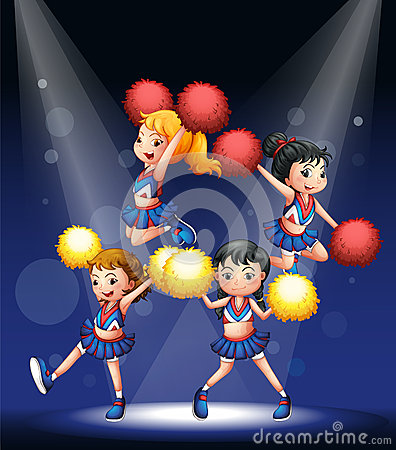 A cheering squad with red and yellow pompoms