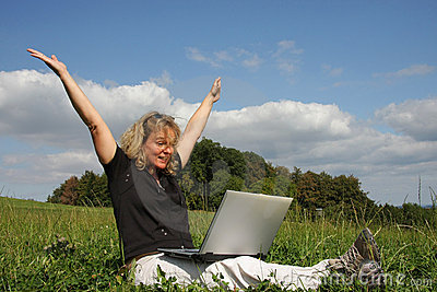 A cheering woman with a laptop